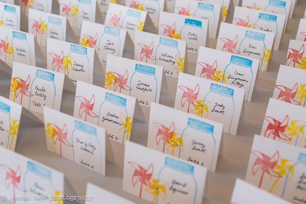 Wedding escort cards with pinwheel picture