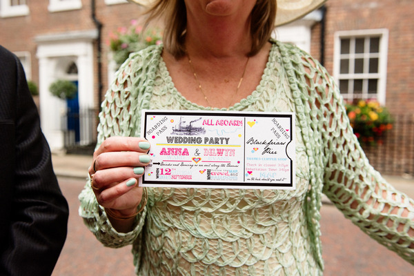 Wedding guest holding ticket to wedding reception