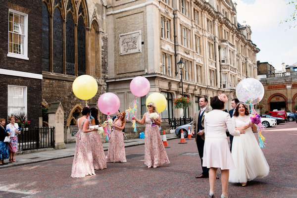 Bridesmaids with pink and yellow balloons
