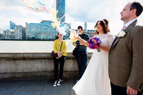 Bride and groom walking in Southbank London