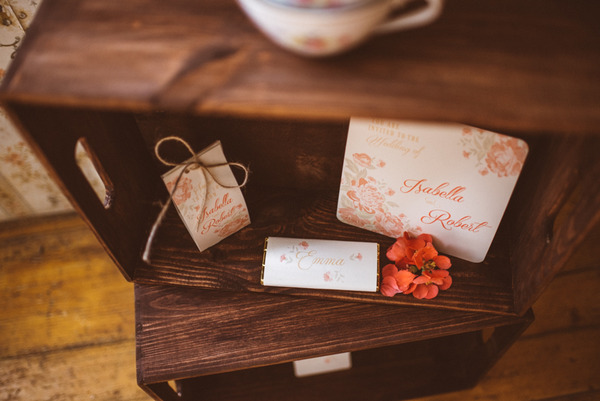Rustic wedding stationery on vintage furniture