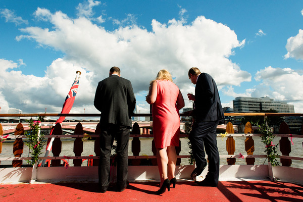Wedding guests looking over side of boat