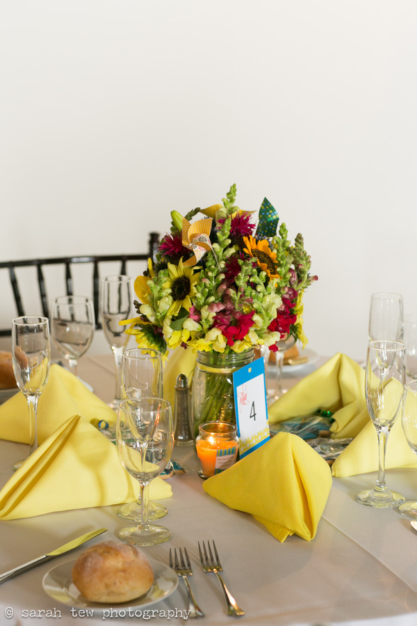 Bright and bold wedding table flowers