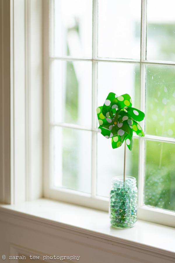 Green pinwheel on window ledge