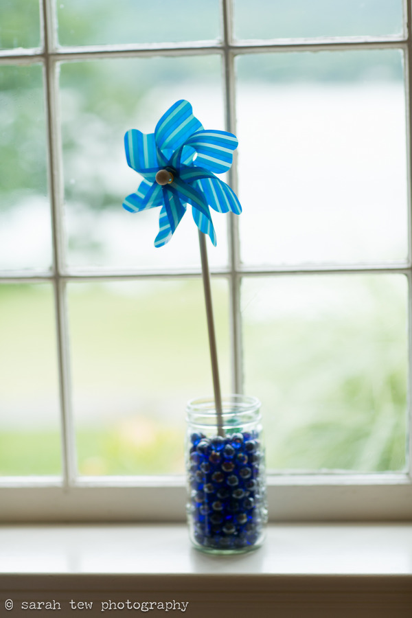 Blue pinwheel on window ledge