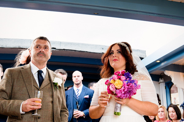 Bride and father listening to wedding speech