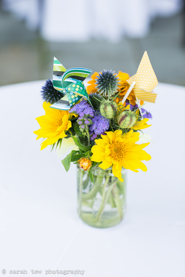 Bright flowers and pinwheels in vase