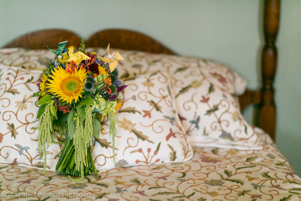 Bright wedding bouquet on bed