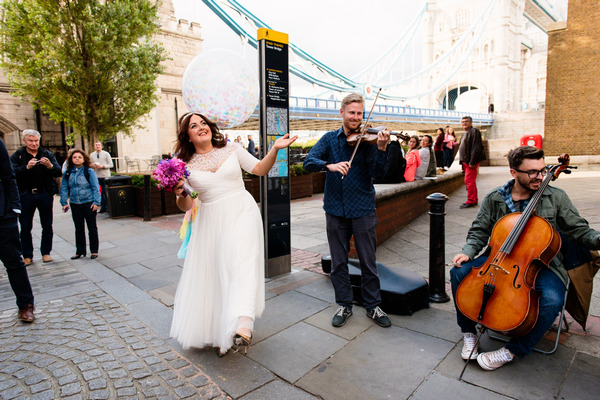 Bride dancing to busker in London