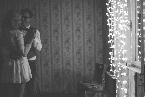 Bride and groom dancing in room or old house