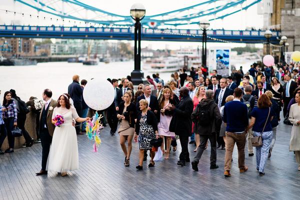 Wedding party walking through London