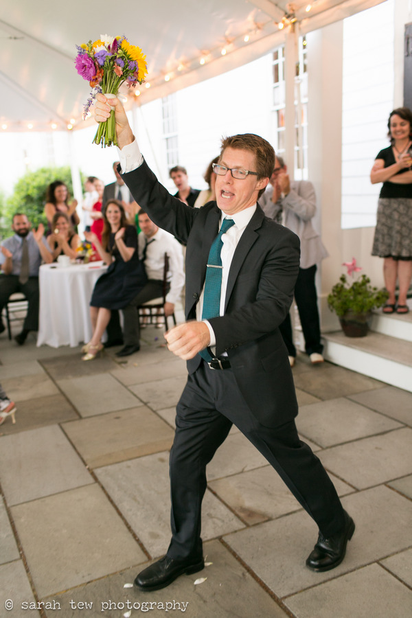 Man catching bride's bouquet