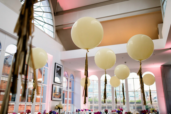 Balloons tied to wedding tables