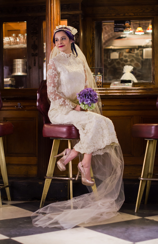 Bride wearing vintage wedding dress with lace sleeves