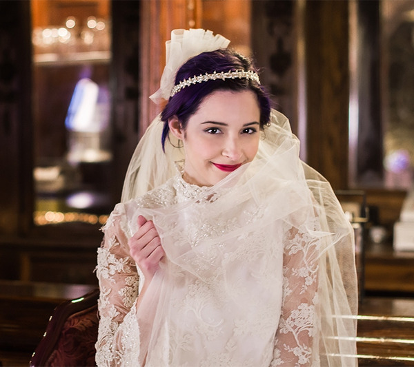 Bride wearing vintage wedding dress and headband