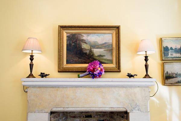 Colourful bouquet on mantelpiece