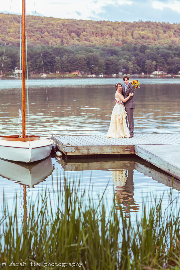 Bride and groom on jetty at Finger Lakes