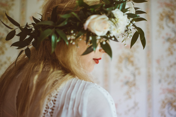 Bride wearing rose and foliage crown