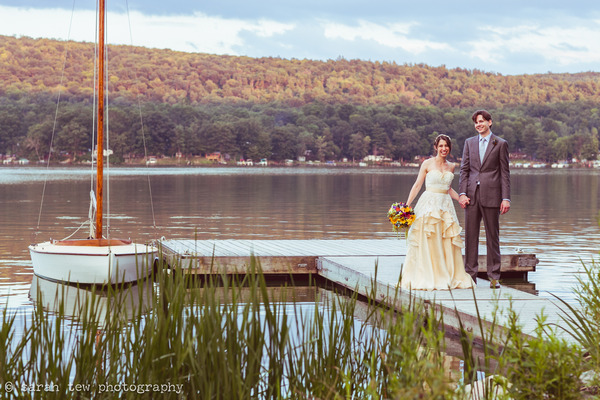 Bride and groom holding hands by Finger Lakes