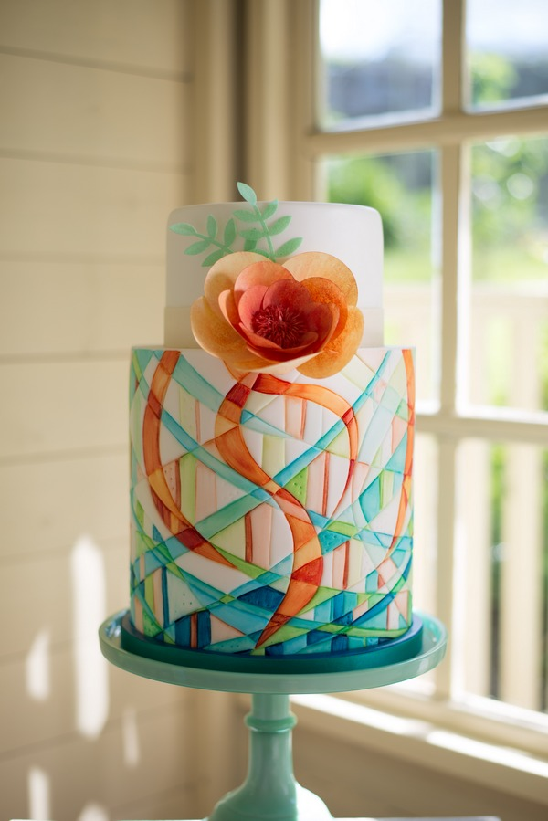 Blue and orange wedding cake from Simply Modern Wedding Cakes