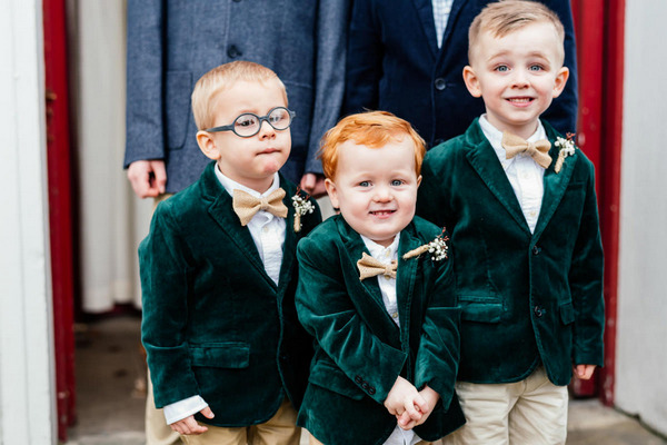 Pageboys in green velvet jackets