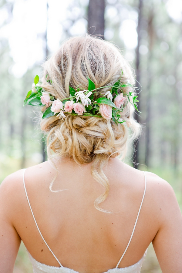 Floral hairpiece in back of bride's updo hairstyle