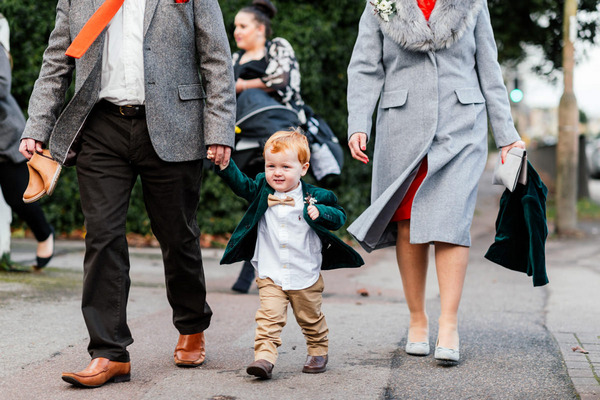 Pageboy walking to wedding ceremony