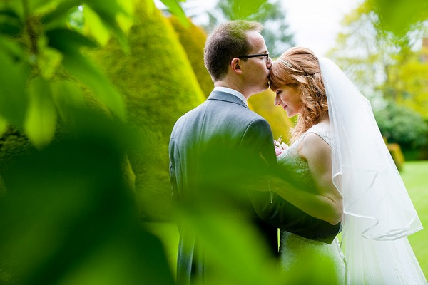 Groom kissing bride on the head - Picture by Geoff Kirby Photography