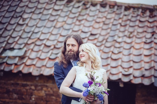 Groom standing behind bride with arms around her waist - Picture by Matty Langley Photography