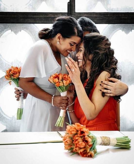 Bride and bridesmaids hugging and smiling - Picture by RR Photographic