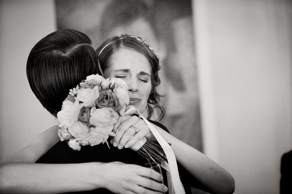 Emotional bride hugging groom - Picture by Steve Gemmell