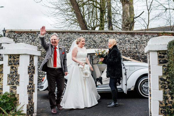 Bride arriving at church with father