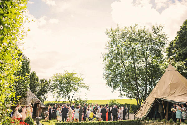Wedding guests in grounds of Woodhill Hall