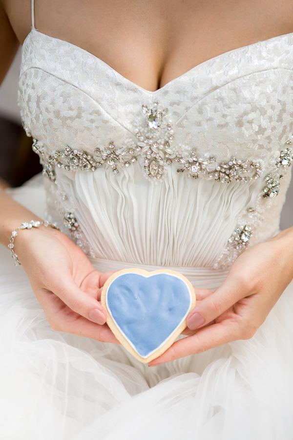 Bride holding heart biscuit