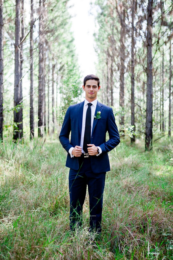 Groom with blue suit in woodland
