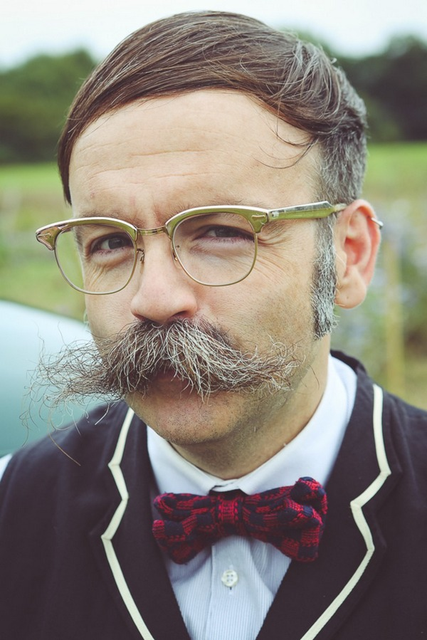 Man with glasses and moustache