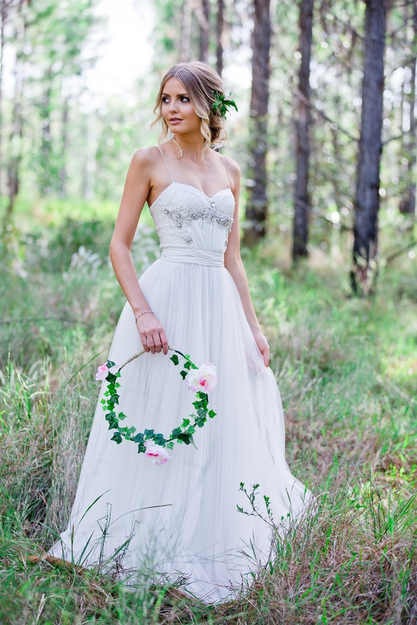 Bride holding floral hoop