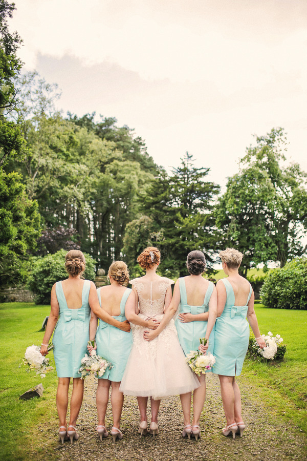 Back of bride with bridesmaids in mint dresses