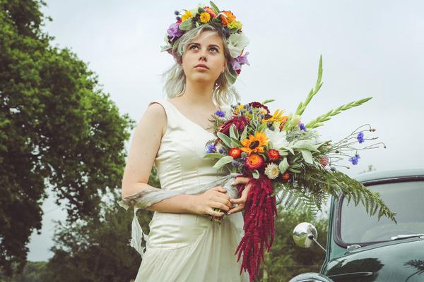 Bride wearing flower crown holding bouquet