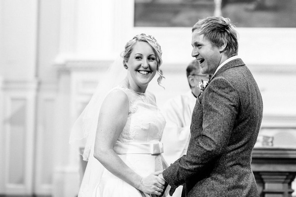 Bride and groom smiling after kiss