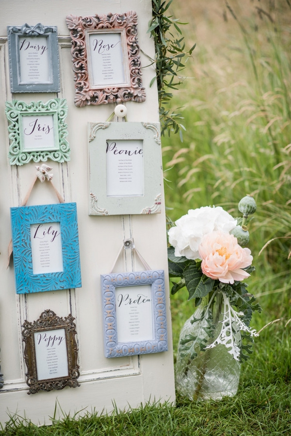 Picture frame wedding seating plan and vase of flowers