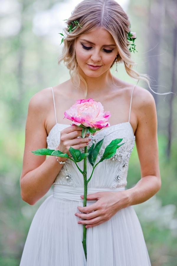 Bride holding large flower