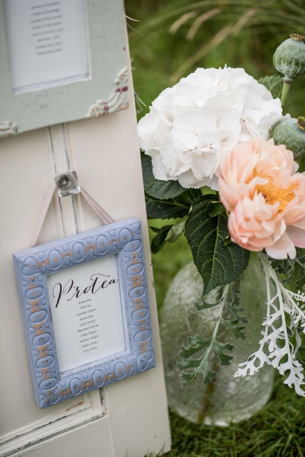 Picture frame on door frame for wedding seating plan