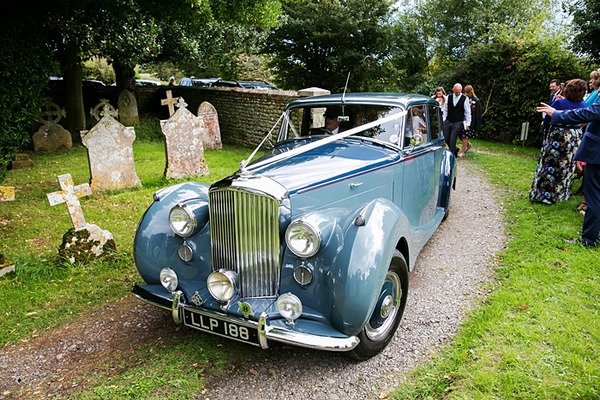 Vintage blue Rolls Royce wedding car