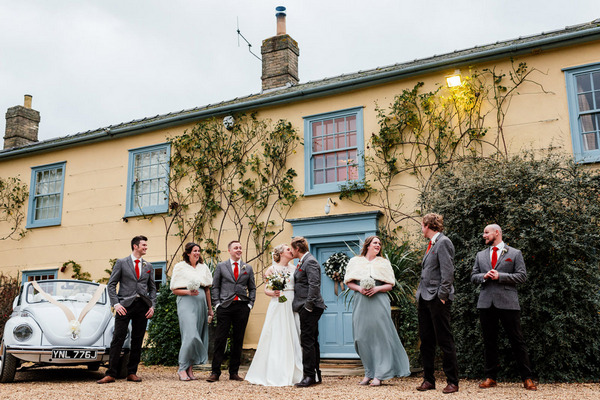 Bridal party outside South Farm, Royston