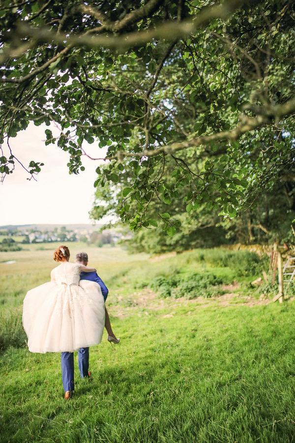 Groom giving bride piggyback
