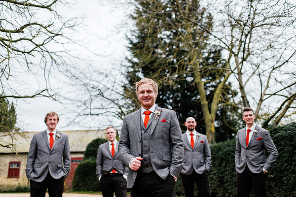 Groomsmen in tweed jackets and orange ties