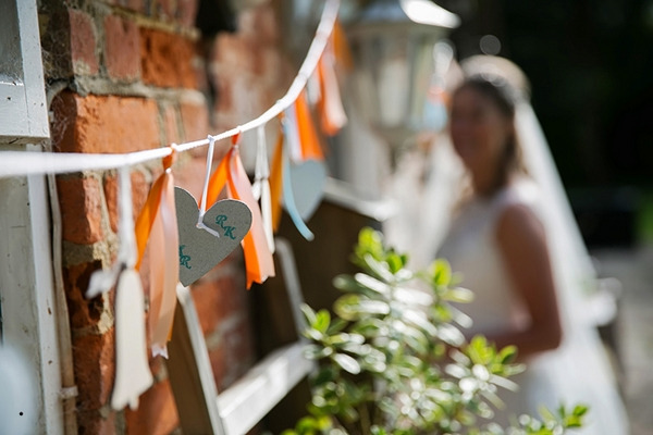 Orange and white tassel wedding decor