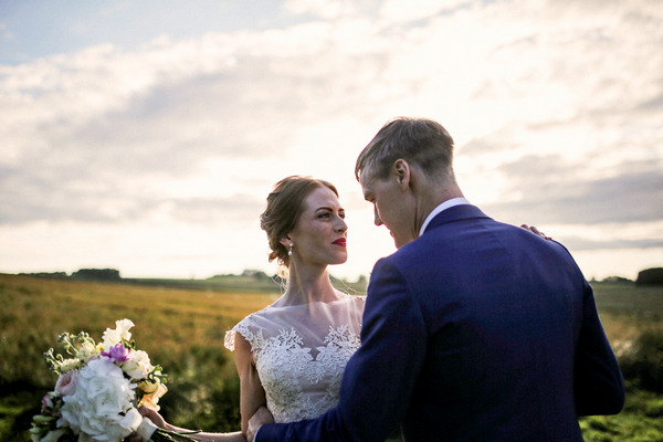Bride and groom in countryside
