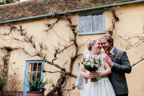 Bride and groom outside South Farm, Royston